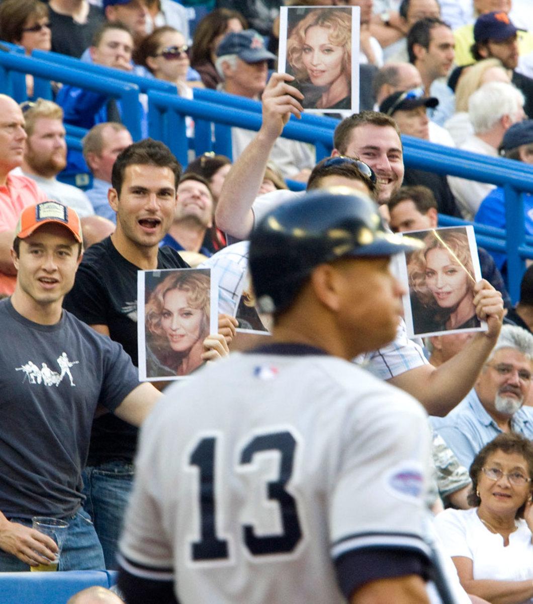 2008-Alex-Rodriguez-fans-Madonna-signs.jpg