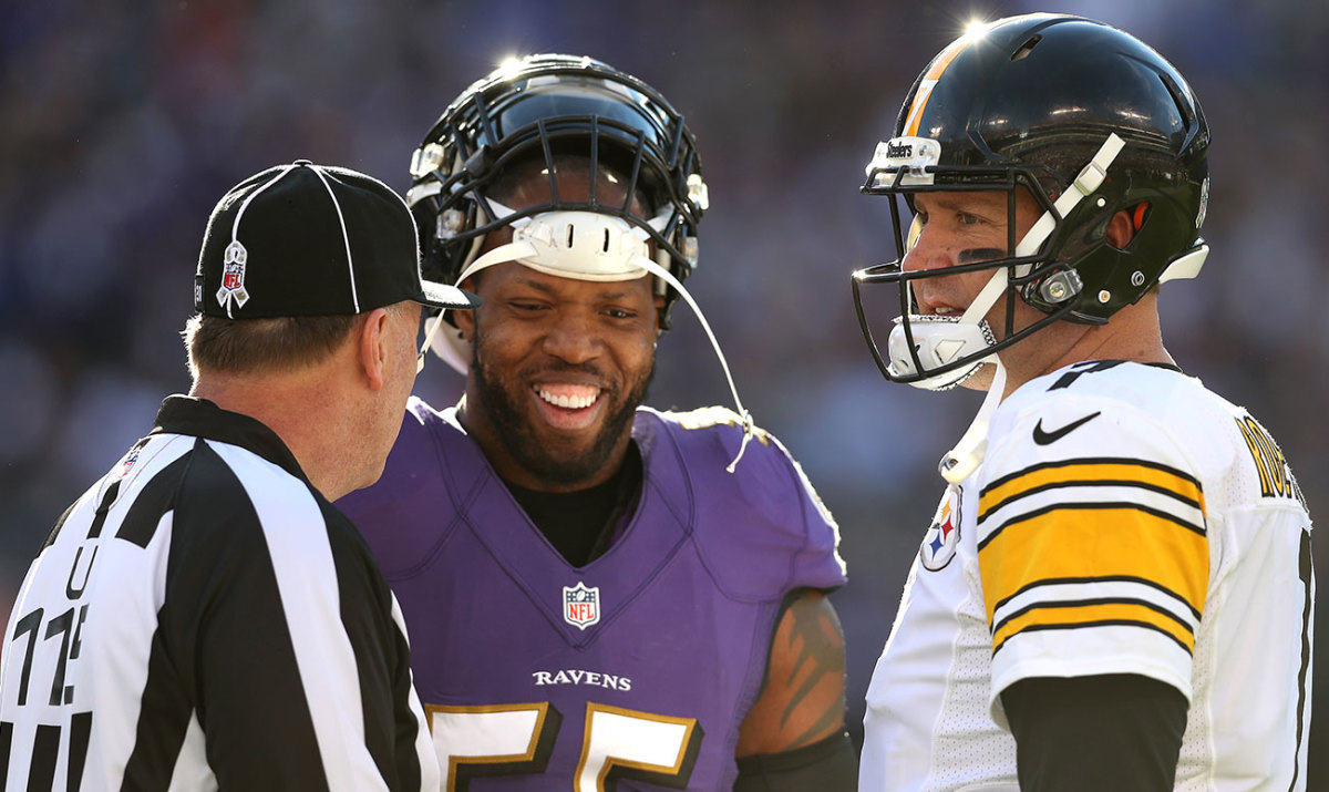 Suggs and Roethlisberger, who've been facing off since 2004, chat with an official during their November meeting this season.