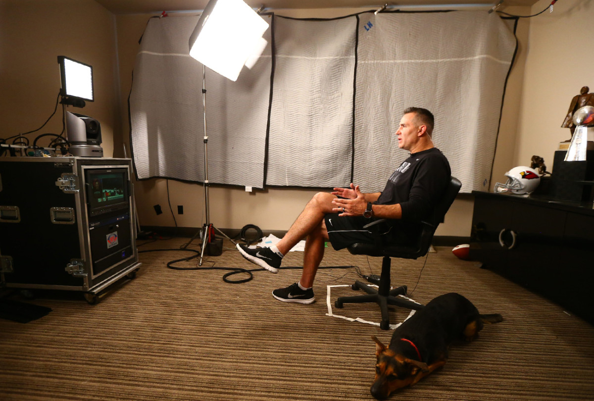 Warner films his midweek NFL Network hit in his home office, his dog, Stella, at his feet.