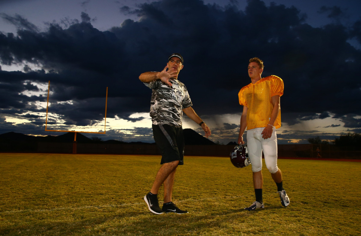 Starting QB Austin Nuessle gets some tips from his OC.