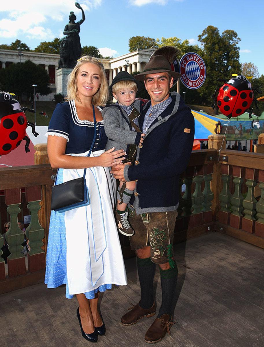 Philipp-Lahm-wife-Claudia-son-Julian-Oktoberfest-490651870.jpg