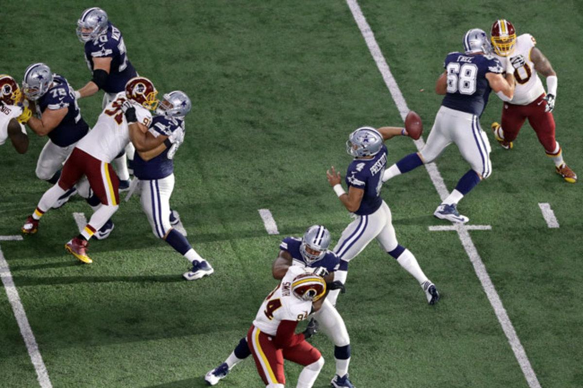 Dak Prescott throws from the pocket against Washington on Thanksgiving.
