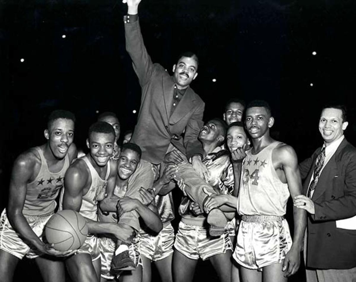Crispus Attucks celebrates a victory after its regional title in 1954.