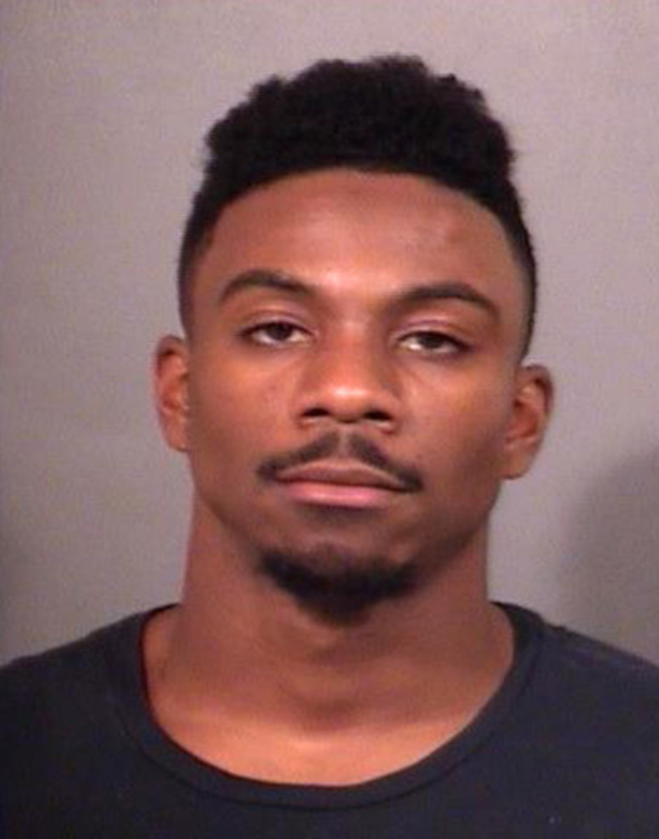 This photo released by the St. Joseph County Jail shows Notre Dame cornerback Devin Butler. Butler was jailed Saturday, Aug. 20, 2016,  after a police officer said the player punched and slammed him to the ground outside a bar, Officers had to use a stun