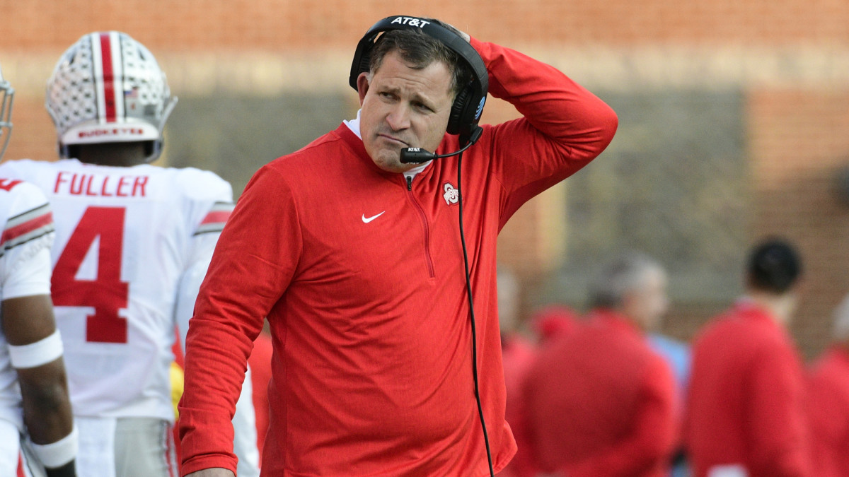 Greg Schiano stands on the sidelines while coaching for Ohio State.