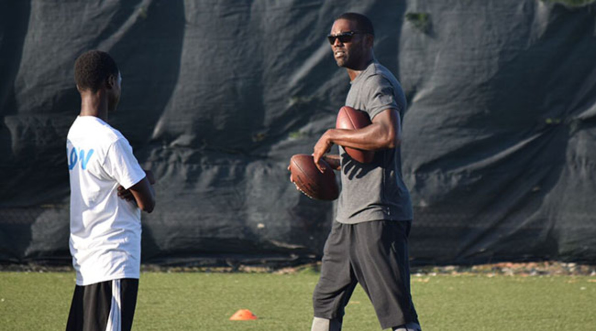 Moss leads drills at the Turks and Caicos Islands American Football Academy.