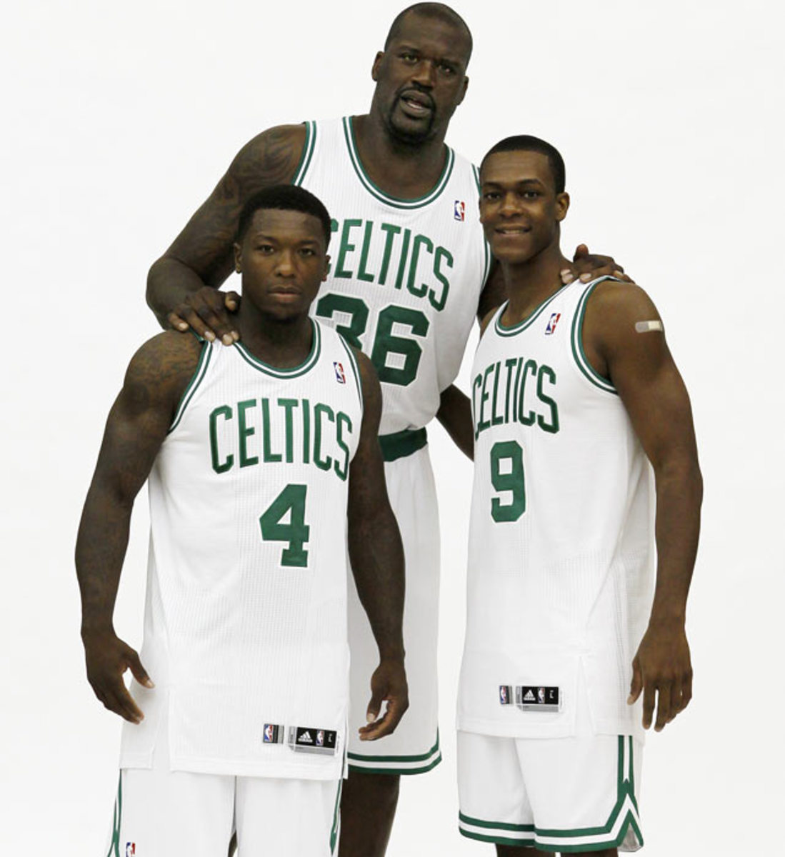 Shaquille O'Neal, Nate Robinson and Rajon Rondo