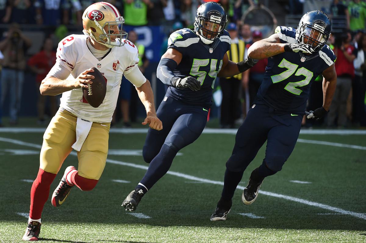 Bobby Wagner (54), Michael Bennett and the Seahawks defense kept Niners quarterback Blaine Gabbert on the run for most of Sunday's game.