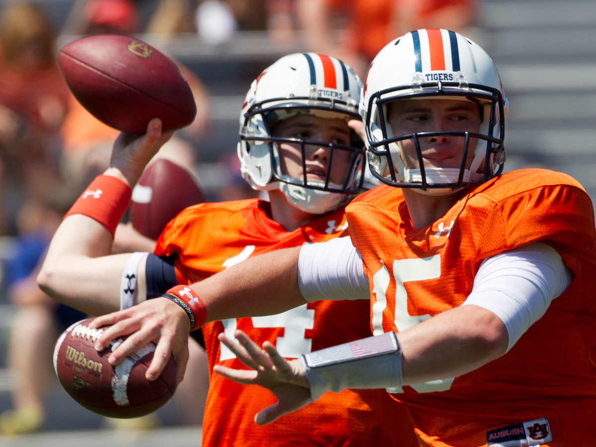Pike (left) arrived at Auburn touted as a potential successor to Cam Newton. He would never play a game for the Tigers.