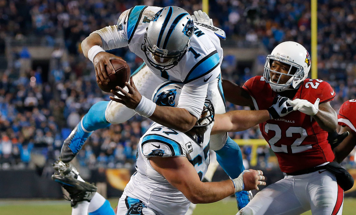 Cam Newton accounted for four touchdowns—two passing and two leaping at the goal line.