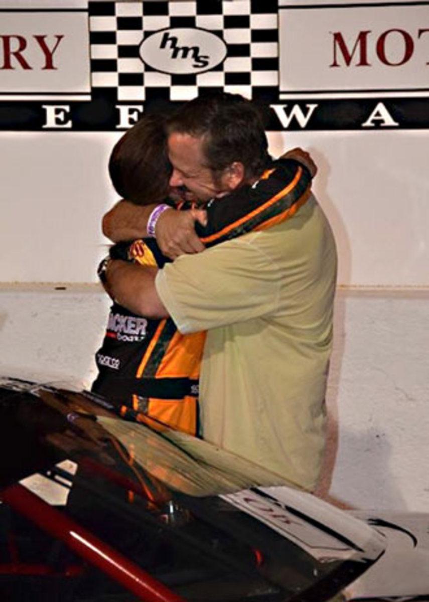 Kate and Wally share a victory hug.