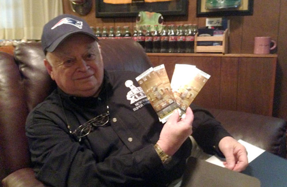 Crisman with tickets to this year's game.