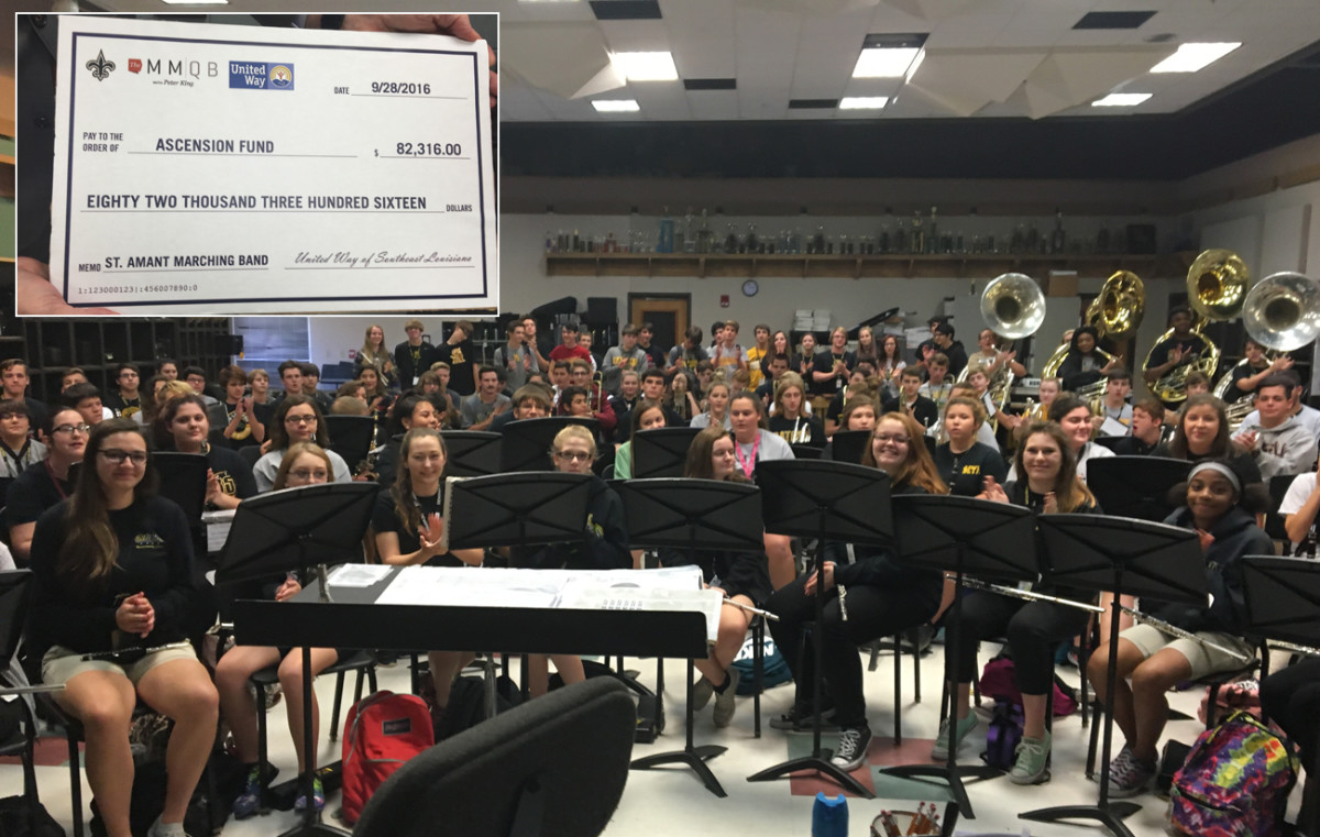 The MMQB, Saints and United Way presented the St. Amant band with a check to help replace equipment damaged by the recent floods in Louisiana.