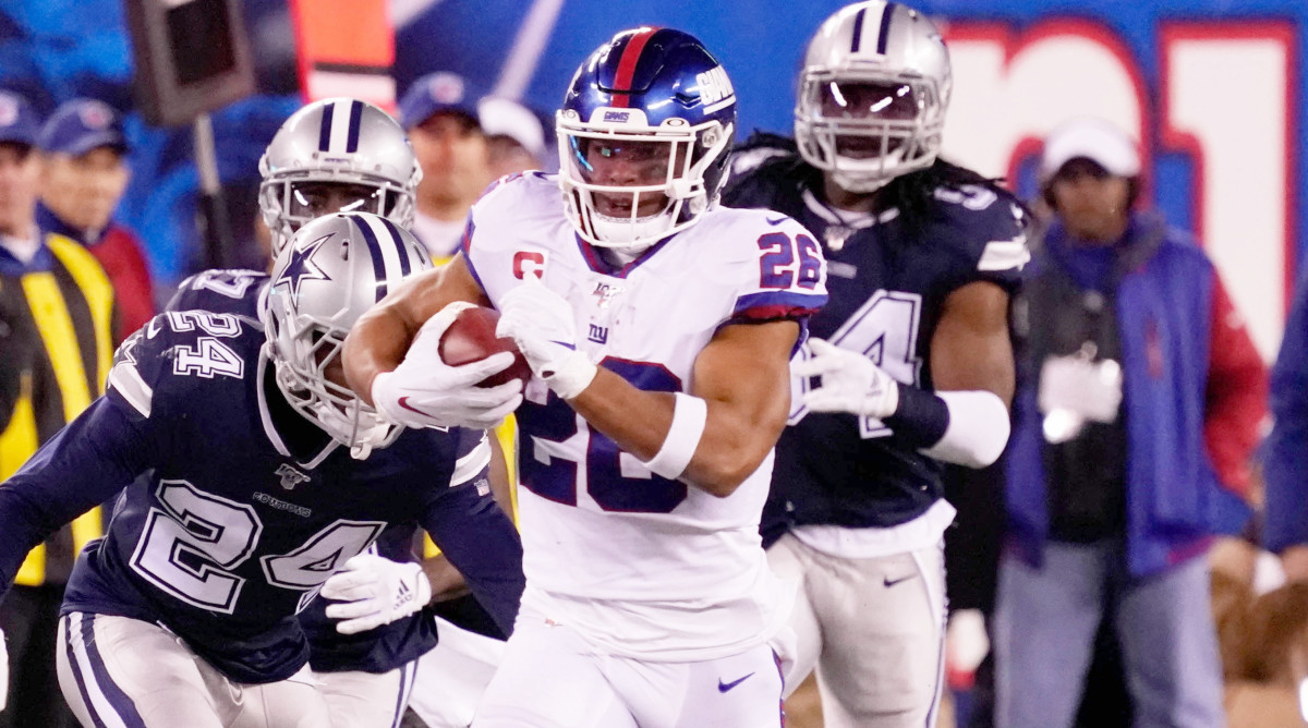 Nov 4, 2019; East Rutherford, NJ, USA;  New York Giants running back Saquon Barkley (26) runs for a 65 yard 1st down ion the 4th quarter at MetLife Stadium. Mandatory Credit: Robert Deutsch-USA TODAY Sports