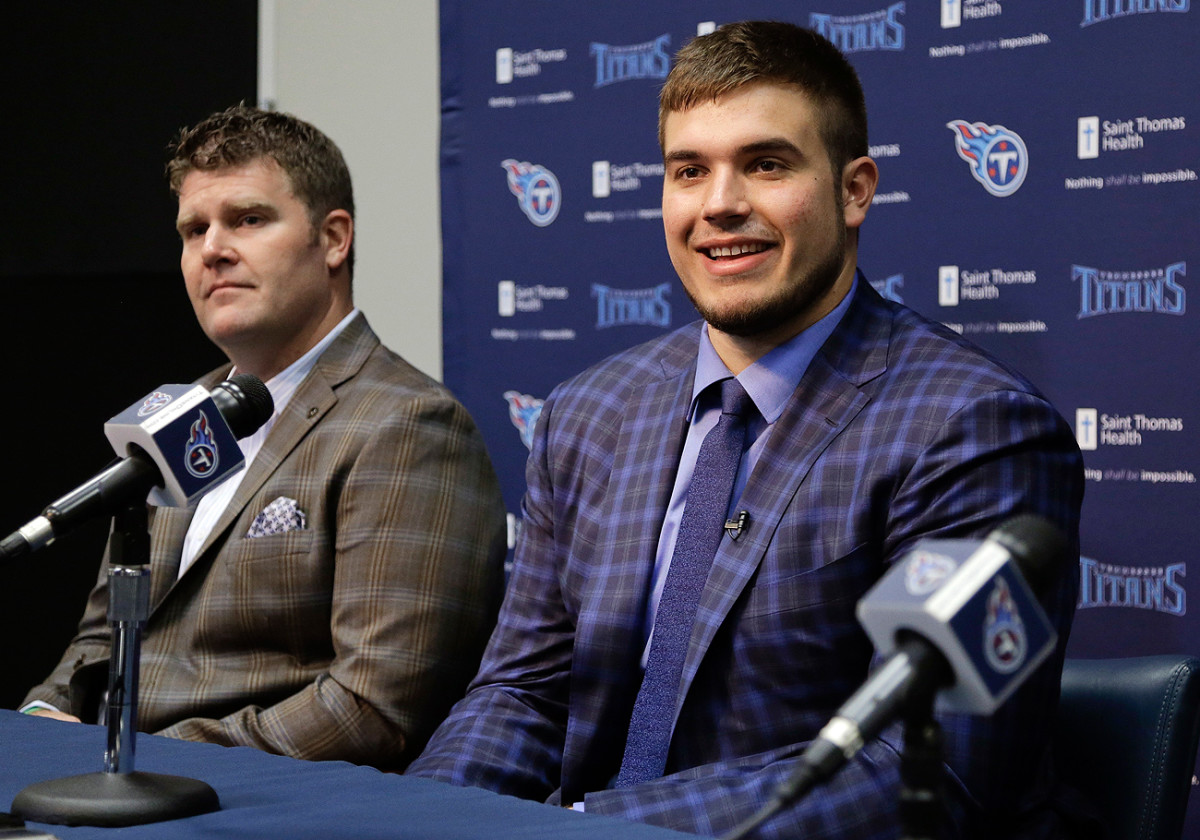 Titans GM Jon Robinson (left) made two draft trades that landed the team, in part, offensive tackle Jack Conklin.