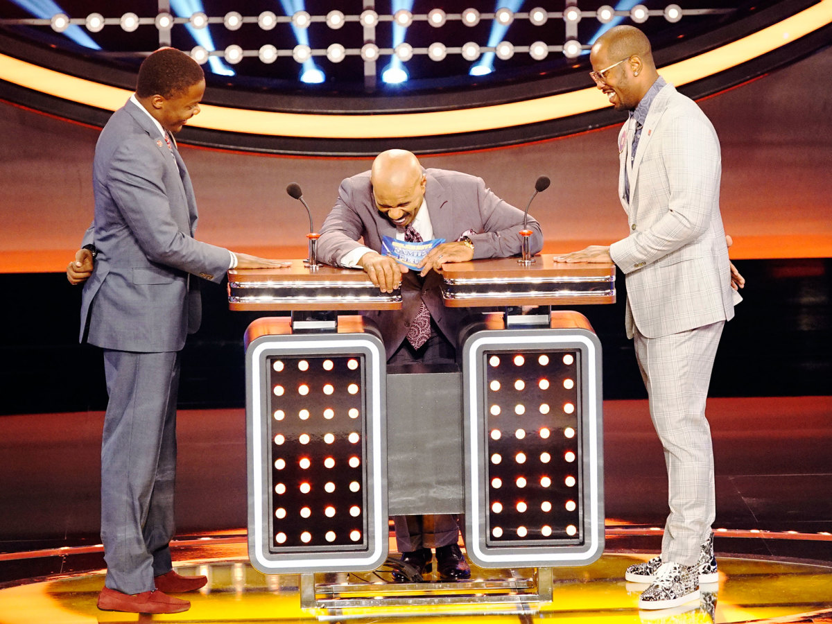 Von Miller (right) and Vikings QB Teddy Bridgewater crack up Family Feud host Steve Harvey.