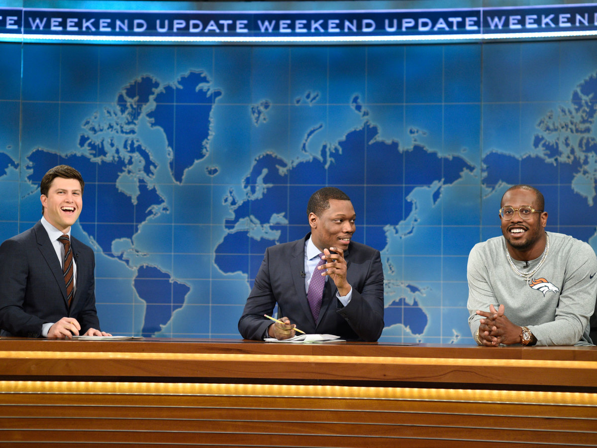 "Miller, with comedians Colin Jost and Michael Che, during his ""Weekend Update"" appearance on Saturday Night Live."