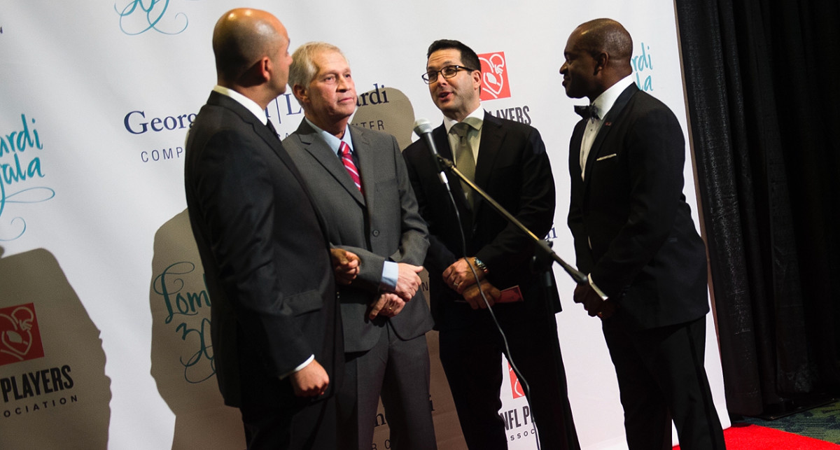 From left to right: George Atallah, Chris Mortensen, Adam Schefter and DeMaurice Smith at an NFLPA gala on Saturday night.