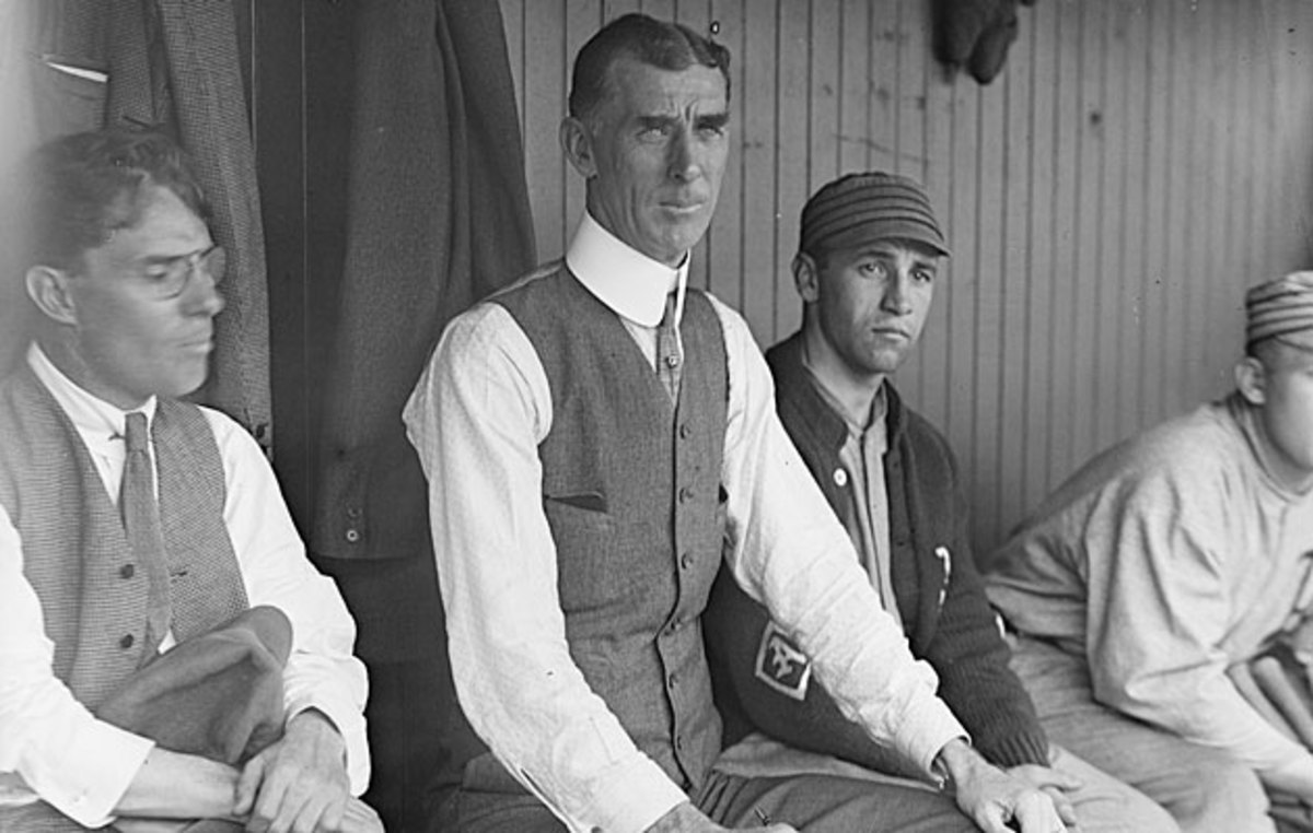 The persuasive Mack (center) convinced the owner to make Mack an equal partner and leave baseball matters in his hands.