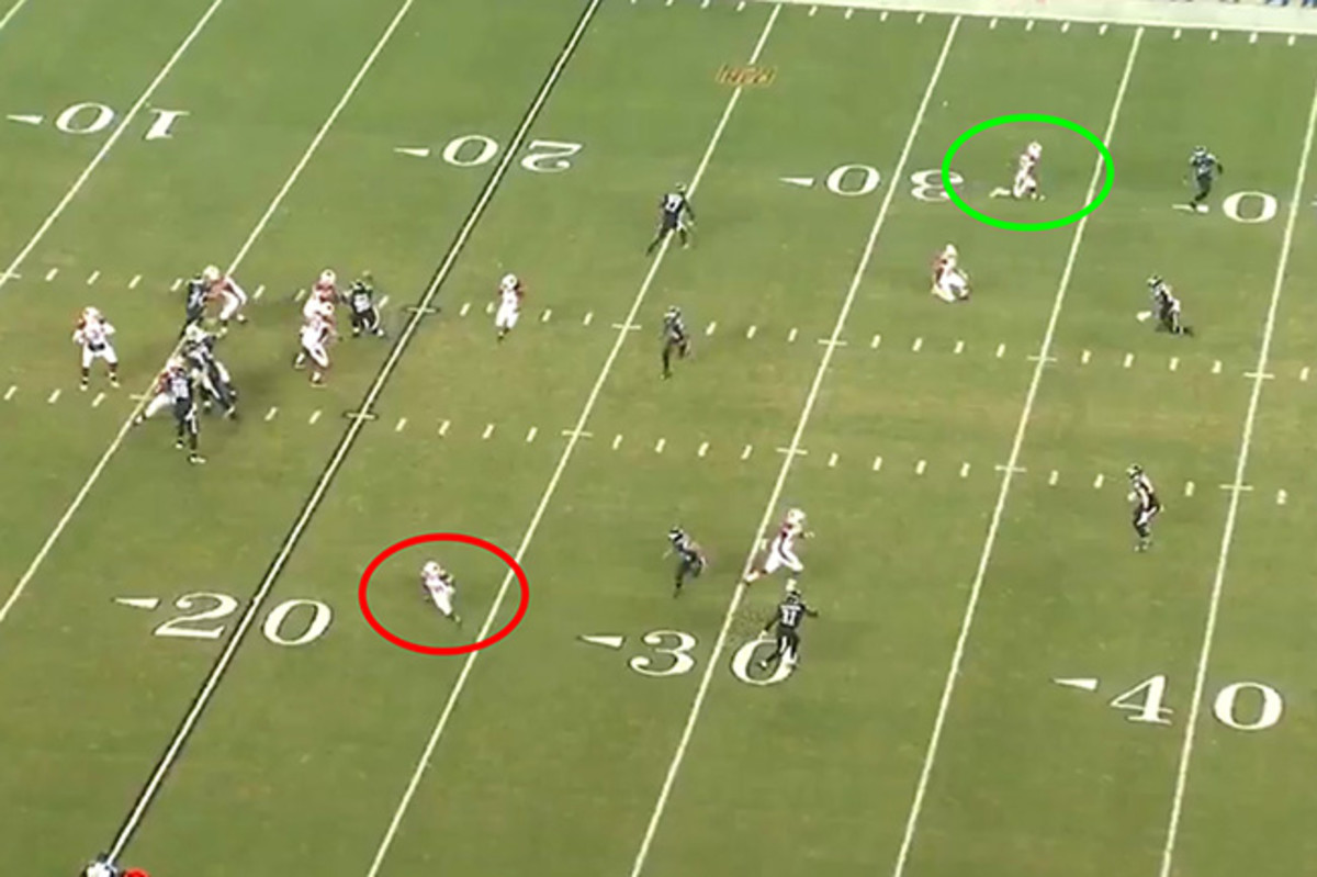 The opening play of the Cardinals' Week 15 Sunday night win in Philadelphia works as designed: Running back David Johnson (circled in red) is open in the flat. But Palmer will instead launch a deep ball for John Brown (circled in green).