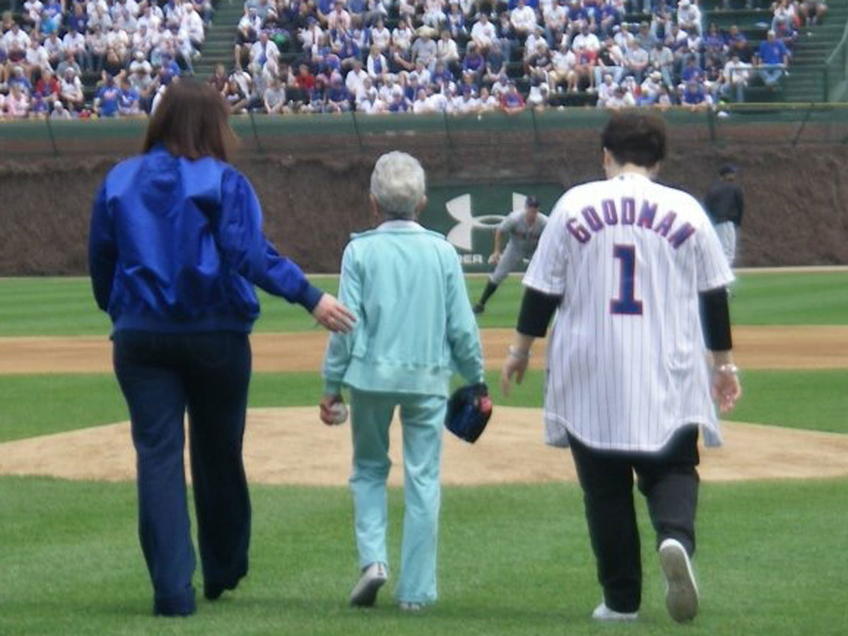 Rosanna (left), wearing her dad's Cubs jacket, and Sarah escort their grandmother, Minnette, to the mound to throw the first pitch before a game at Wrigley in 2008.