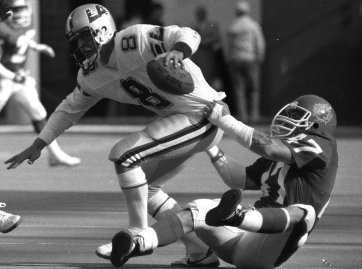 For plenty of players like John Joyce, here wrangling future Hall-of-Famer Steve Young in an '85 game at the Meadowlands, the USFL was their only taste of the pros.