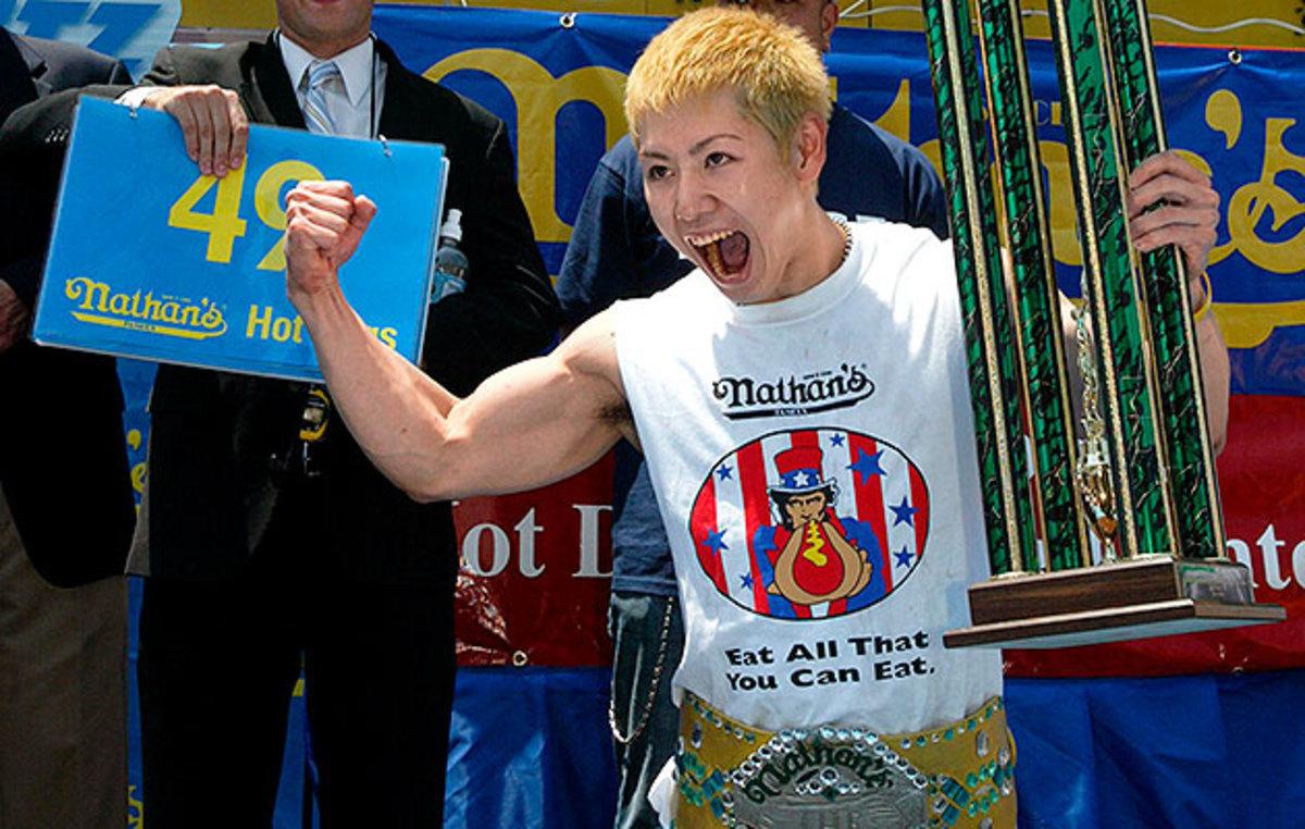 Kobayashi's winning hot dog totals: 50 in 2001, 50 1/2 in 2002, 44 1/2 in 2003, 53 1/2 in 2004, 49 in 2005, 53 3/4 in 2006.