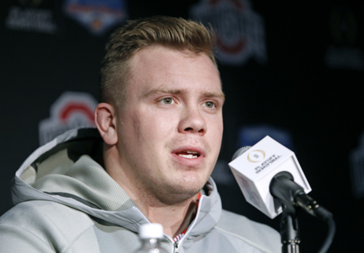 Ohio State's Pat Elflein speaks to the media after arriving with his team at Phoenix Sky Harbor Airport on Monday Dec. 26, 2016, in Phoenix. Ohio State will play Clemson in the Fiesta Bowl as part of the college football playoff semifinal on Dec. 31, 2016