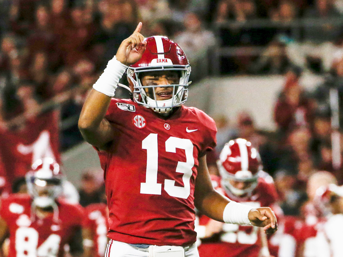 Oct 19, 2019; Tuscaloosa, AL, USA; Alabama Crimson Tide quarterback Tua Tagovailoa (13) celebrates after a touchdown during the first half of an NCAA football game against the Tennessee Volunteers at Bryant-Denny Stadium. Mandatory Credit: Butch Dill-USA TODAY Sports