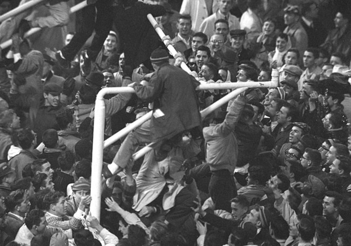 Colts fans tear down the goalposts after the '59 title-game win. Richardson no doubt would like to see something similar after Super Bowl 50.