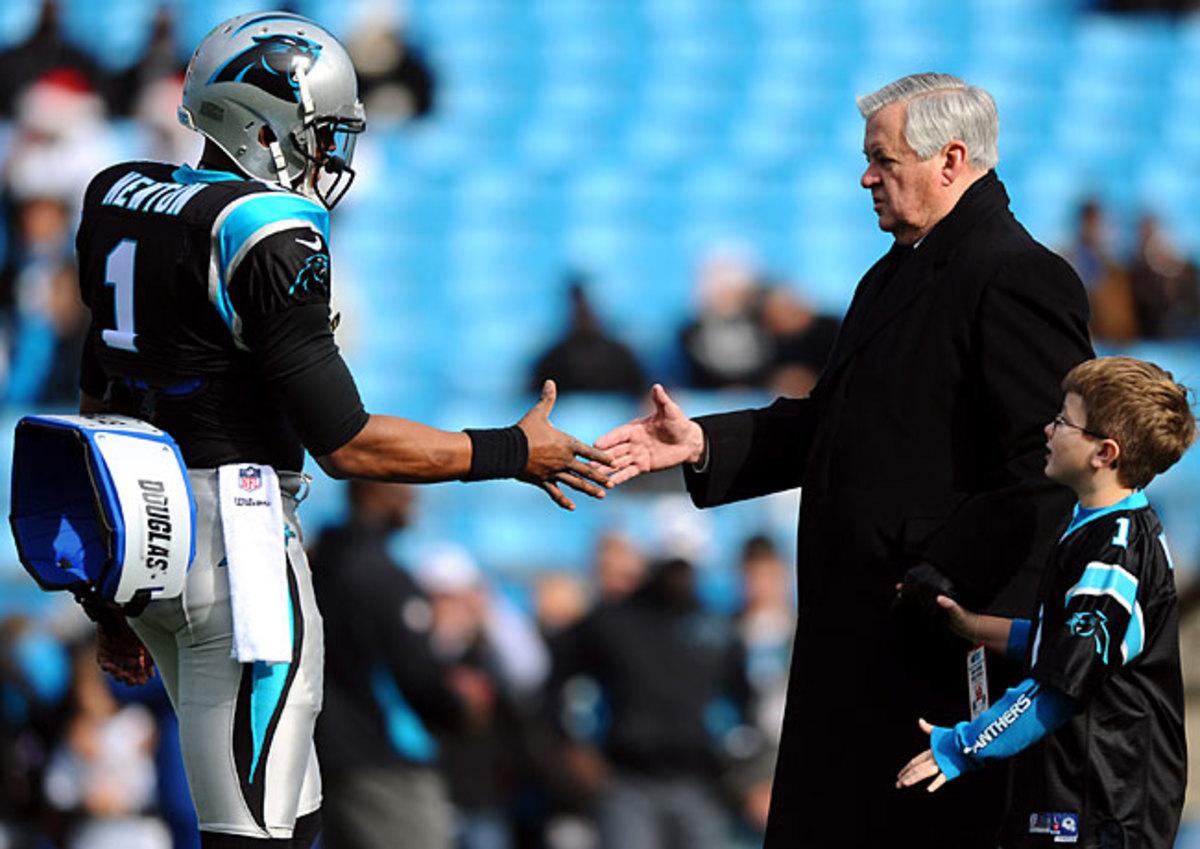 Jerry Richardson with his quarterback, Cam Newton.