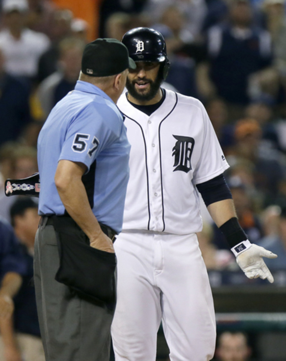 Detroit Tigers' J.D. Martinez talks with home plate umpire Mike Everitt after being ejected from the baseball game against the Los Angeles Angels during the sixth inning Saturday, Aug. 27, 2016, in Detroit. The Angels defeated the Tigers 3-2. (AP Photo/Du