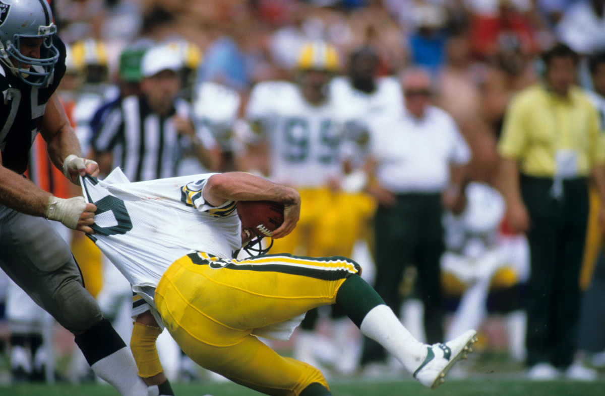 Howie Long gets shirty with Packers quarterback Randy Wright during the 1984 season.