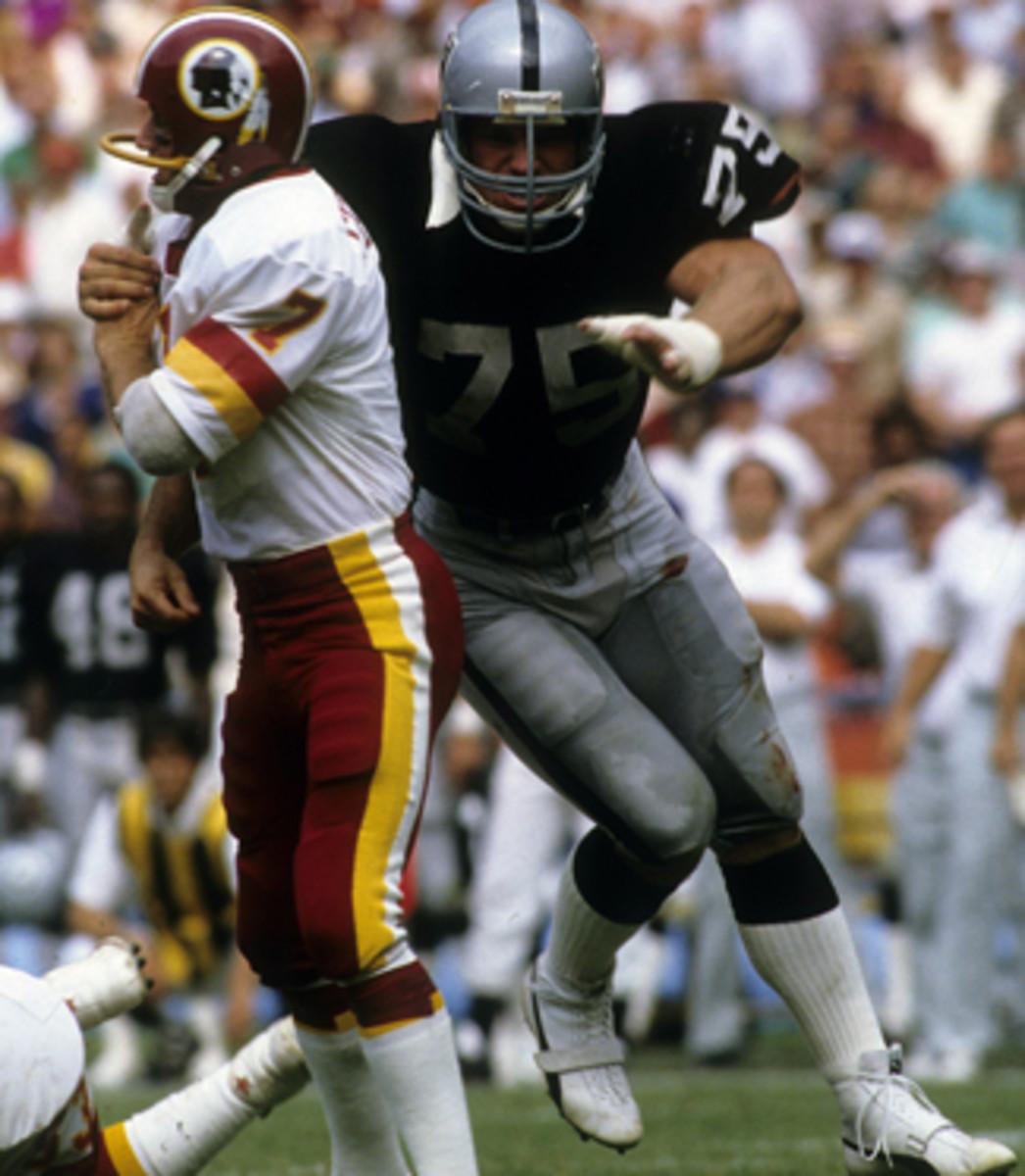 Long hits Joe Theismann in Super Bowl XVIII.