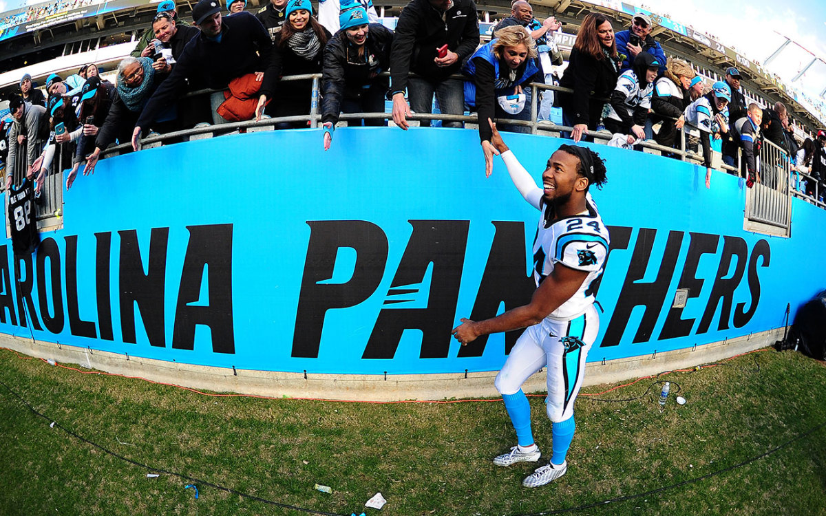 Norman celebrates with Panthers fans after the NFC title game win.