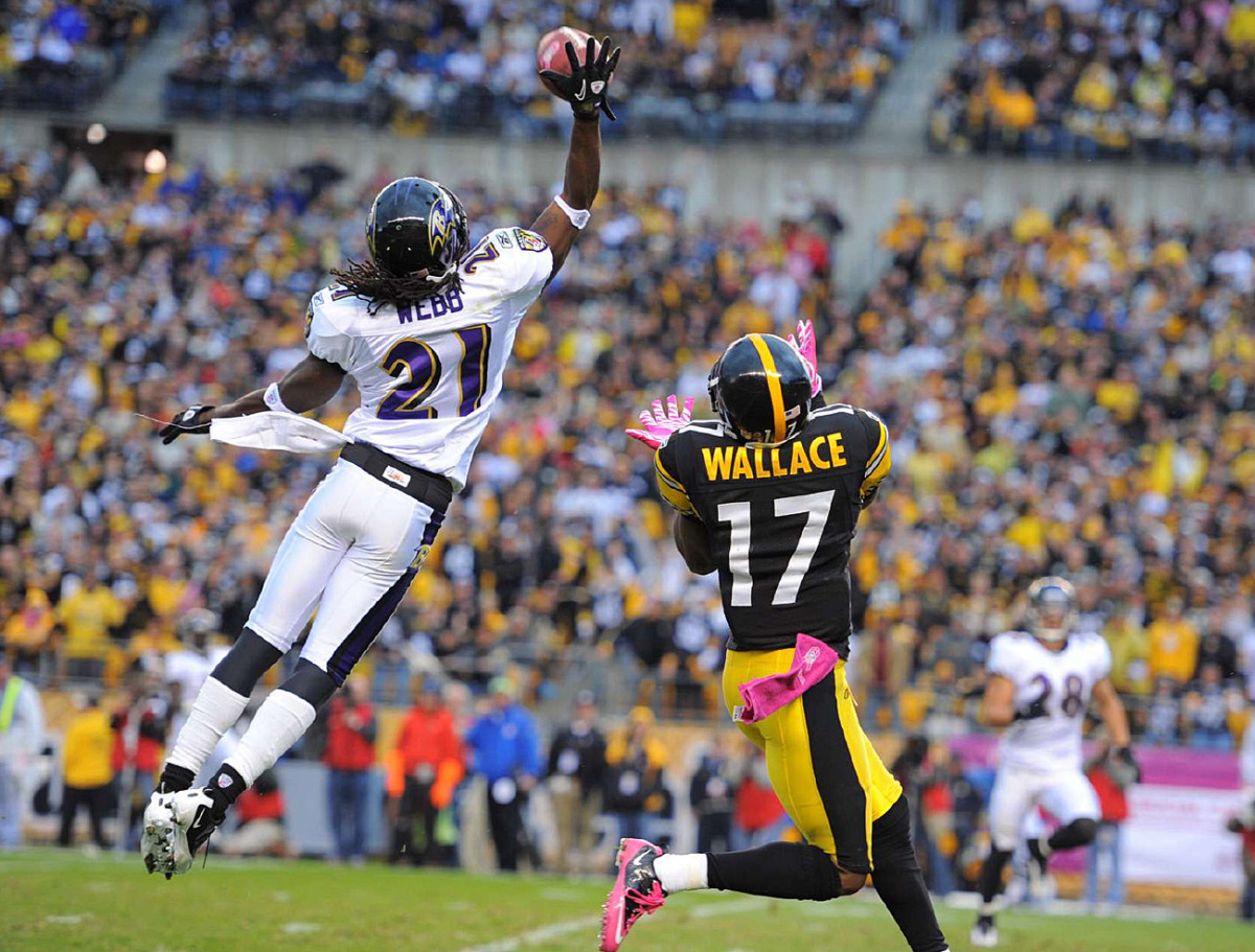 Lardarius Webb breaks up a pass to Mike Wallace, October 2010.