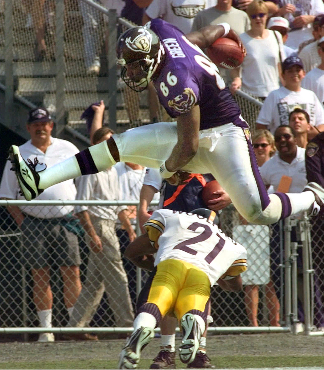 Eric Green goes high over Donnell Woolford in a 1997 game at old Memorial Stadium.
