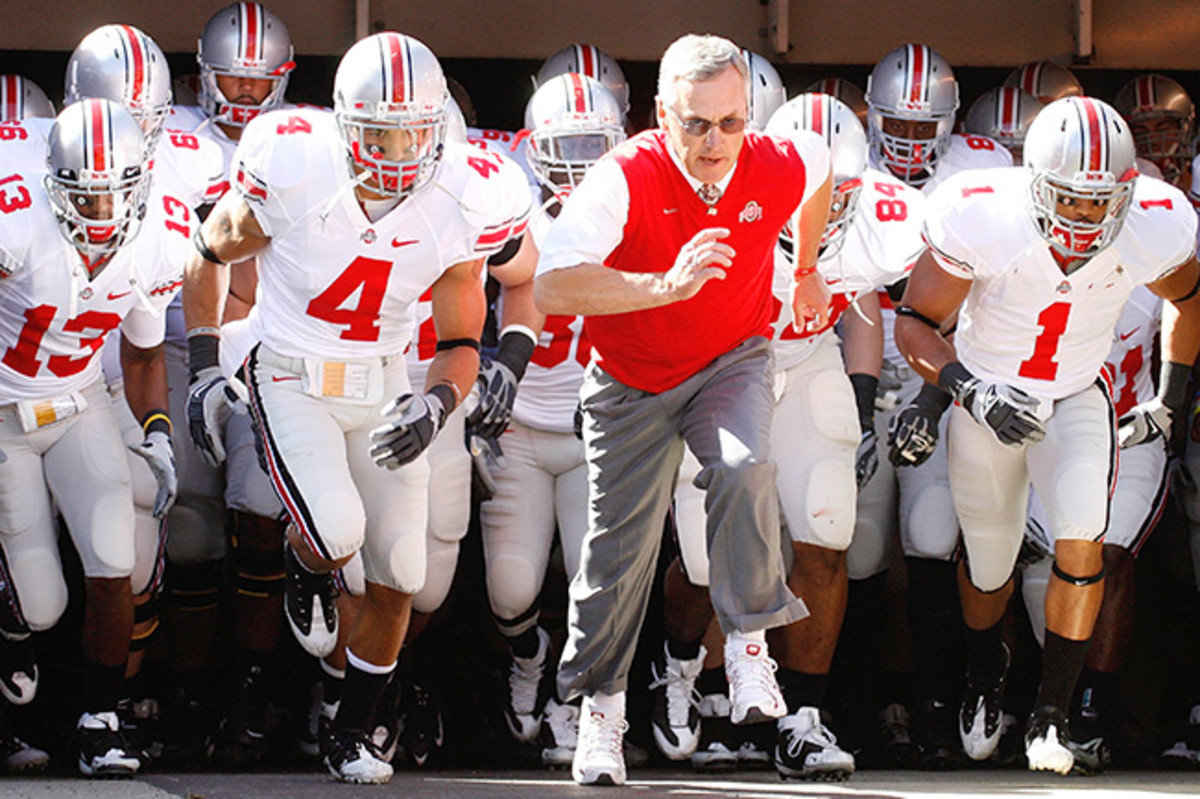 Tressel and Kurt Coleman (No. 4) led Ohio State out of the tunnel before a 2009 game against Akron