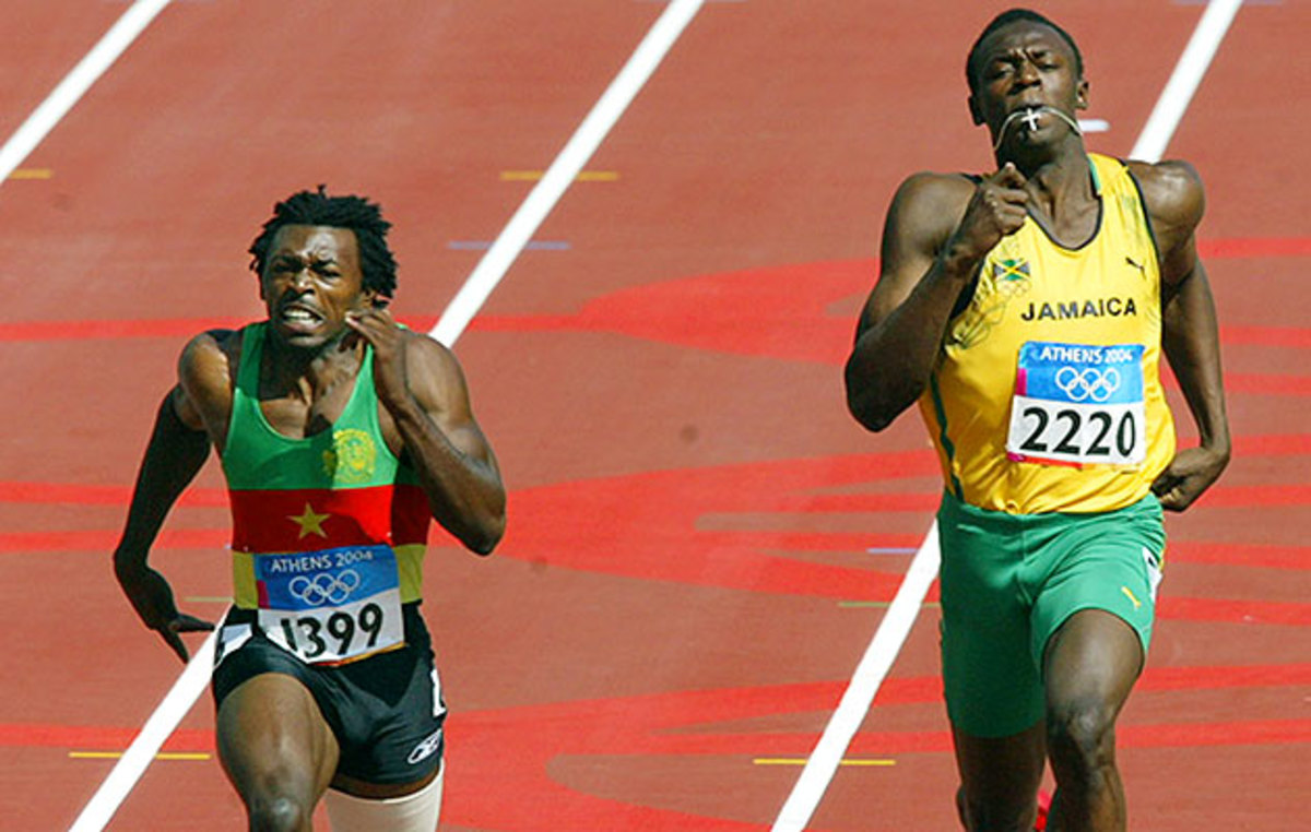 At the 2004 Olympics, Usain Bolt (right) runs next to Joseph Batangdon of Cameroon in the first round of the 200 meters.