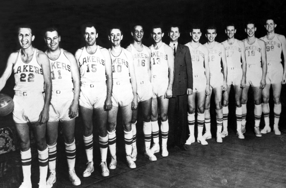 The 1950 NBA champion Minneapolis Lakers, with Bud Grant (just to the right of coach John Kundla, in suit, in photo), and George Mikan (far right).