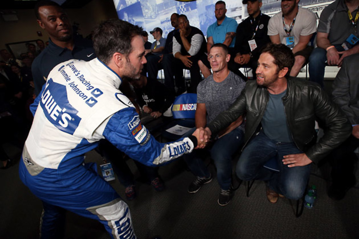 Jimmie Johnson greets Grand Marshal Gerard Butler.