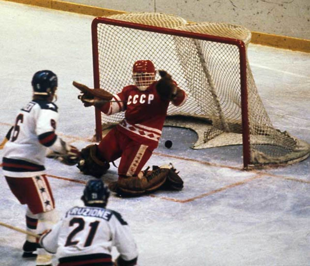 Mike Eruzione (21) of the U.S. wristed the winning goal past Vladimir Myshkin at Lake Placid in 1980.