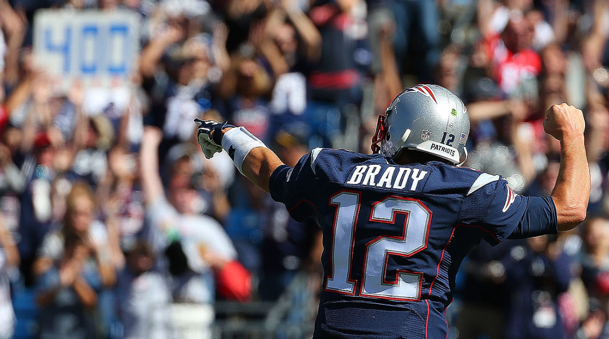 Tom Brady is the fourth QB with 400 career passing touchdowns, joining Peyton Manning, Brett Favre and Dan Marino. (Jim Rogash/Getty Images)