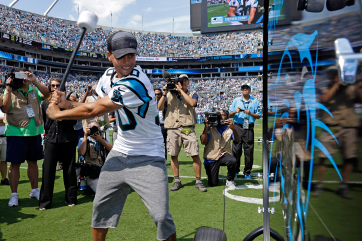 Golden State Warriors guard Stephen Curry bangs the drum before the Carolina Panthers' home-opener in September.