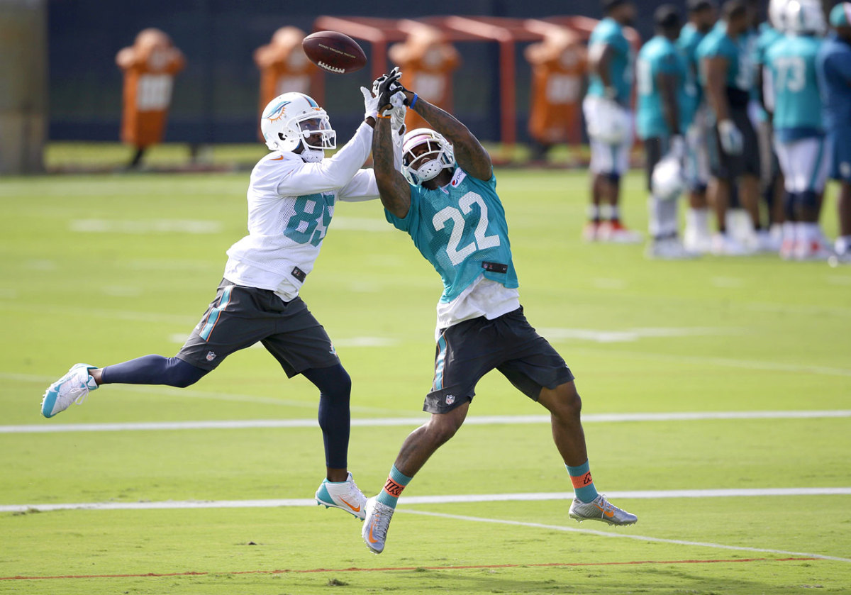Miami-Dolphins-Jamar-Taylor-Greg-Jennings.jpg