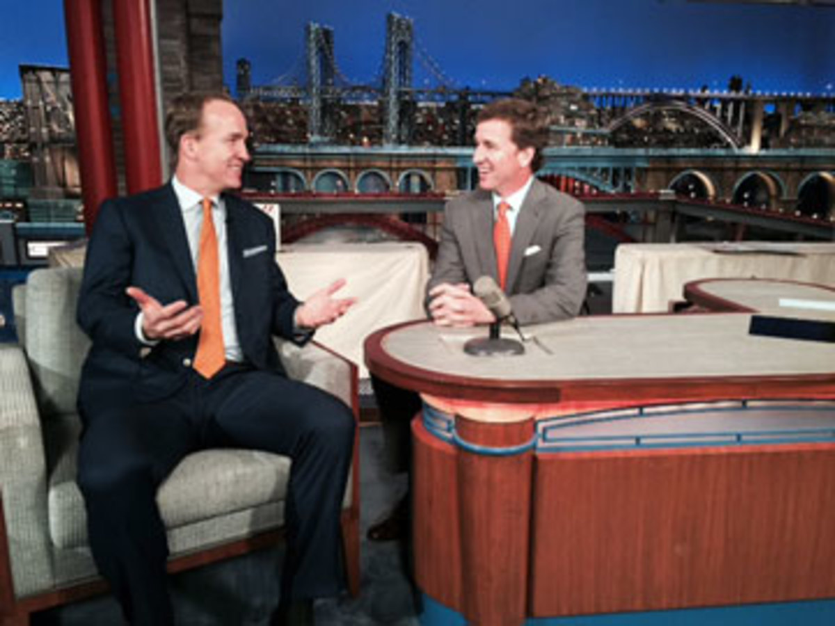 """Before the """"Late Show"""" finale, Cooper Manning sat behind Letterman's desk and pretended to interview his younger brother. (Courtesy photo)"""