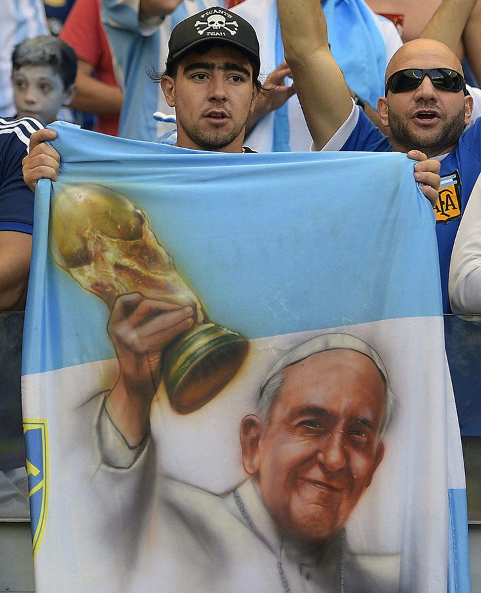2014-0621-Argentina-fan-Pope-Francis-flag.jpg