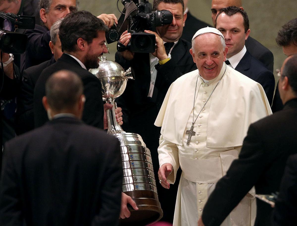 2014-0819-Matias-Lammens-Copa-Libertadores-trophy-Pope-Francis.jpg
