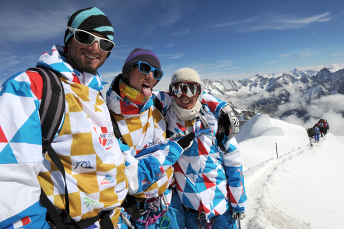 Members of the French national snowboard team (left to right) Tony Mathieu, Crepel Ramoin and Alouan Ricardi pose after reaching the top of the Aiguille du Midi in Chamonix, France.
