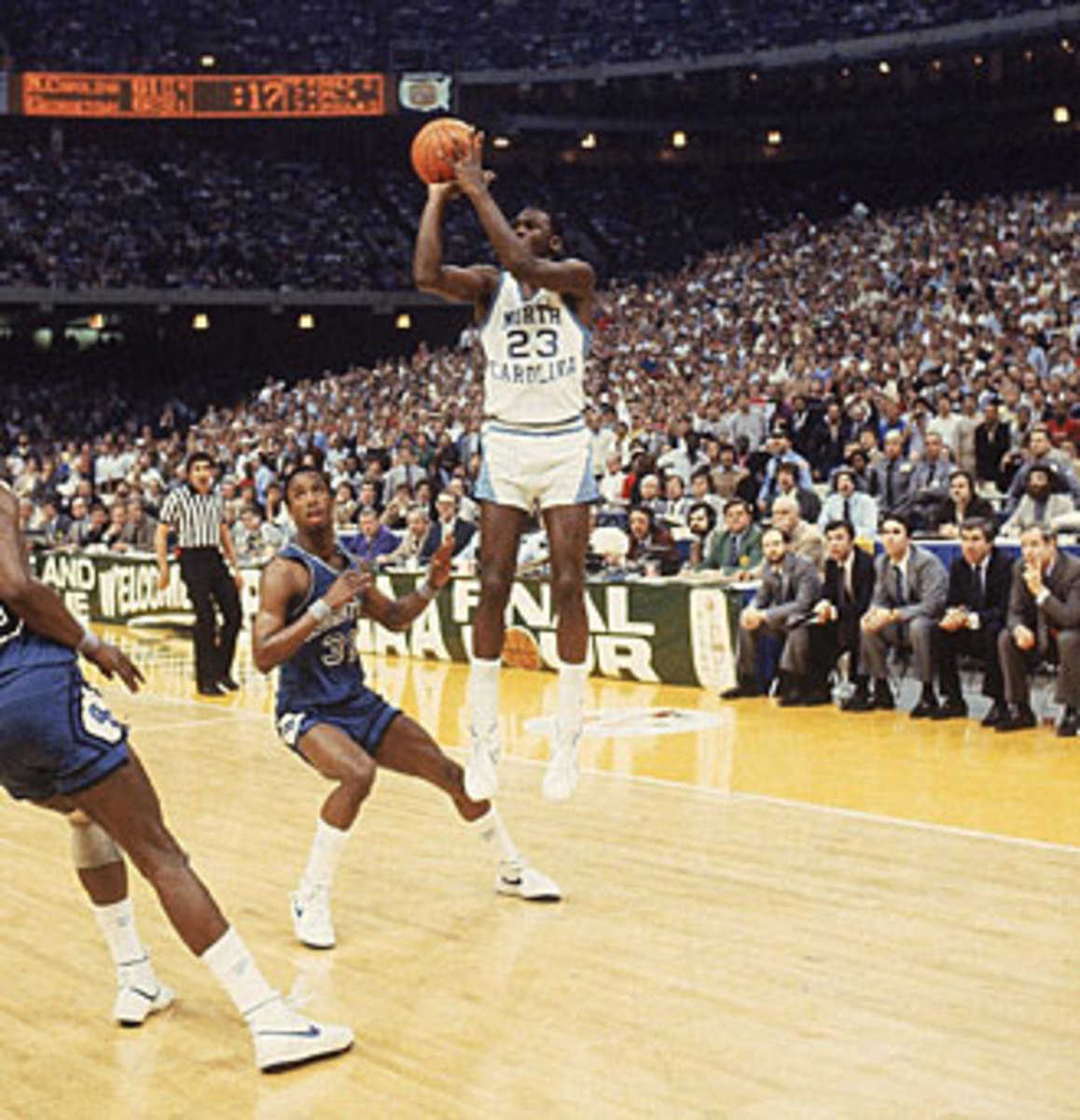 With Smith looking on, a freshman named Michael Jordan hit the shot that won the 1982 NCAA championship.